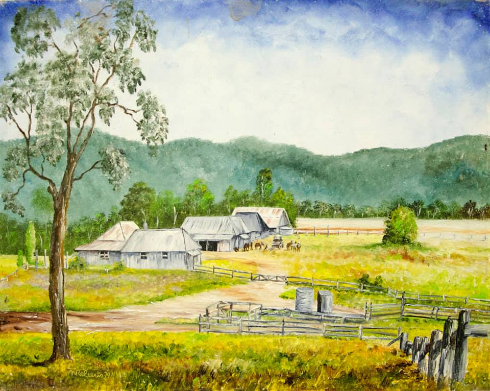 Oil painting of Dumgree based on the 1913 photograph.  The grey of the timber stockyards and buildings contrasts with green grass and the mountains in the background.