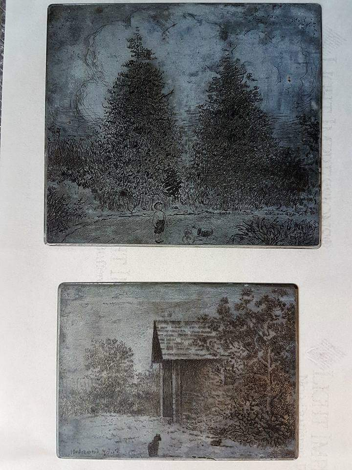 Two of Ruby Campbell's etching plates.  The plates are grey metal, and the top image is of a small boy standing on a pathway in a garden of pine trees.  The lower image is of a black cat sitting in front of a small building or shed.