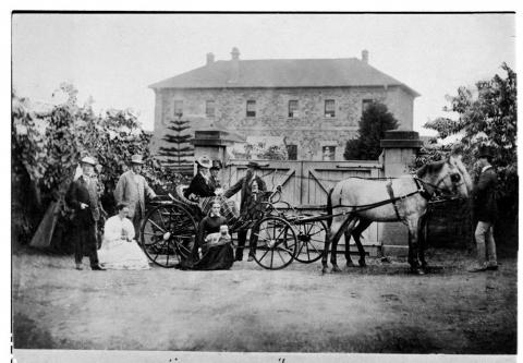 Archer family with horse-drawn carriage in front of Brisbane military barracks.