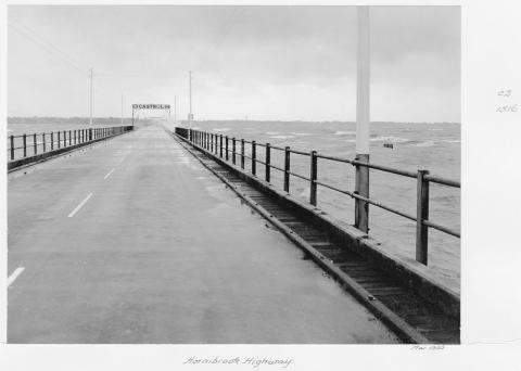 View from along the old Hornibrook Bridge towards Clontarf/Woody Point with Castrol banner sign in the distance.