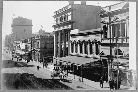 View of Queen Street in the 1920s Brisbane showing building facades