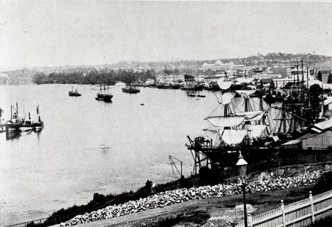 View of Brisbane River in the 19th century with large sailboats moored