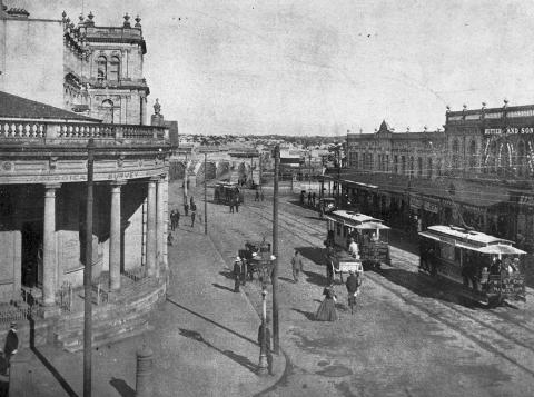 Corner of George and Queen Street facing towards Victoria Bridge c1908.