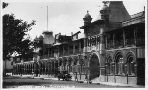 View of Queens Hotel, Townsville, featuring car and patrons.