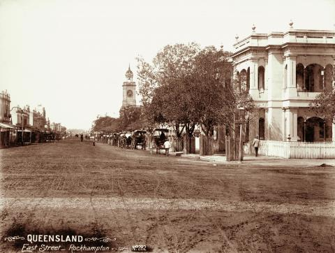 View of East Street, Rockhampton featuring the Post Office and horses