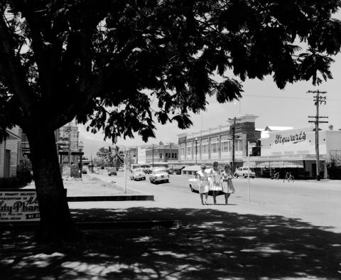View of Denham Street, Rockhampton featuring cars and buildings