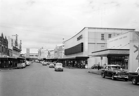 View of Russell Street, Toowoomba in 1961 including buildings and vehicles.