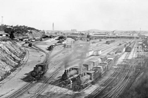 Roma Street Railway Station with steam trains in foreground, c 1936