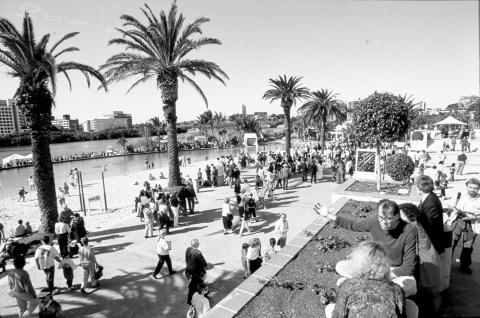 Loads of people visiting Southbank beach, in inner-city Brisbane