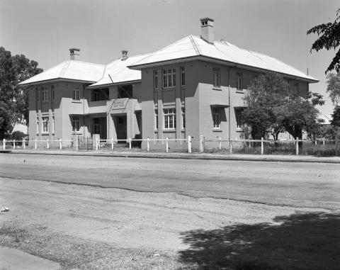 Exterior of Charleville courthouse, a Victorian stone building with tin roof