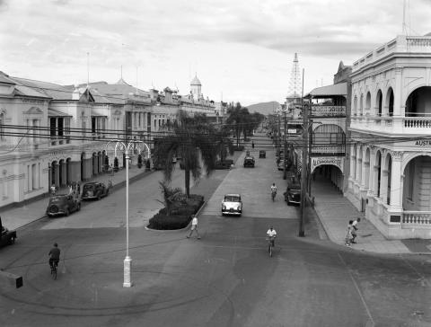 View of the main street of Townsville with people gathered on the street