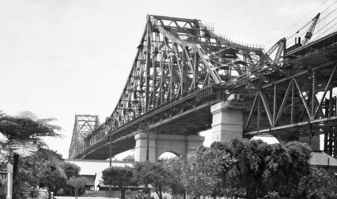View of the iconic Story Bridge seen from the base on the southern side of the Brisbane River banks