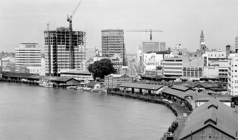 Sweeping river of the new Brisbane CBD towers being built on the waterfront in the 1960s