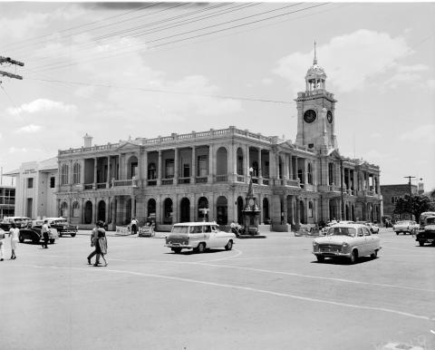External view of the Rockhampton post office, a grand Victorian building with clock tower and stone walls