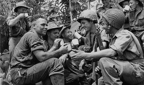 Australian troops chat to American paratroops who landed at Nadzab, New Guinea, c 1942 - 1945