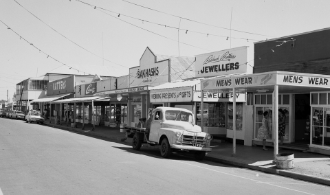 Street view within Cloncurry showing the main street with shops and truck parked out of the front