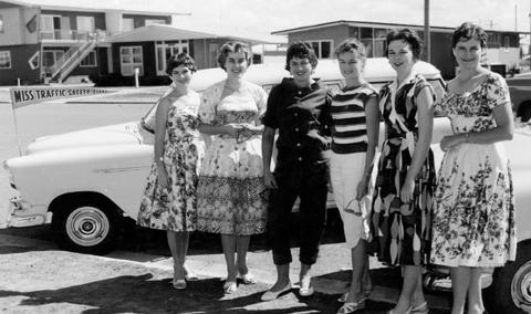 Several girls lining up for a beauty shot in 1950s Gold Coast