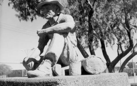 Statue of a seated swagman at Winton commemorating the Waltzing Matilda song composed by Banjo Patterson, June 1966
