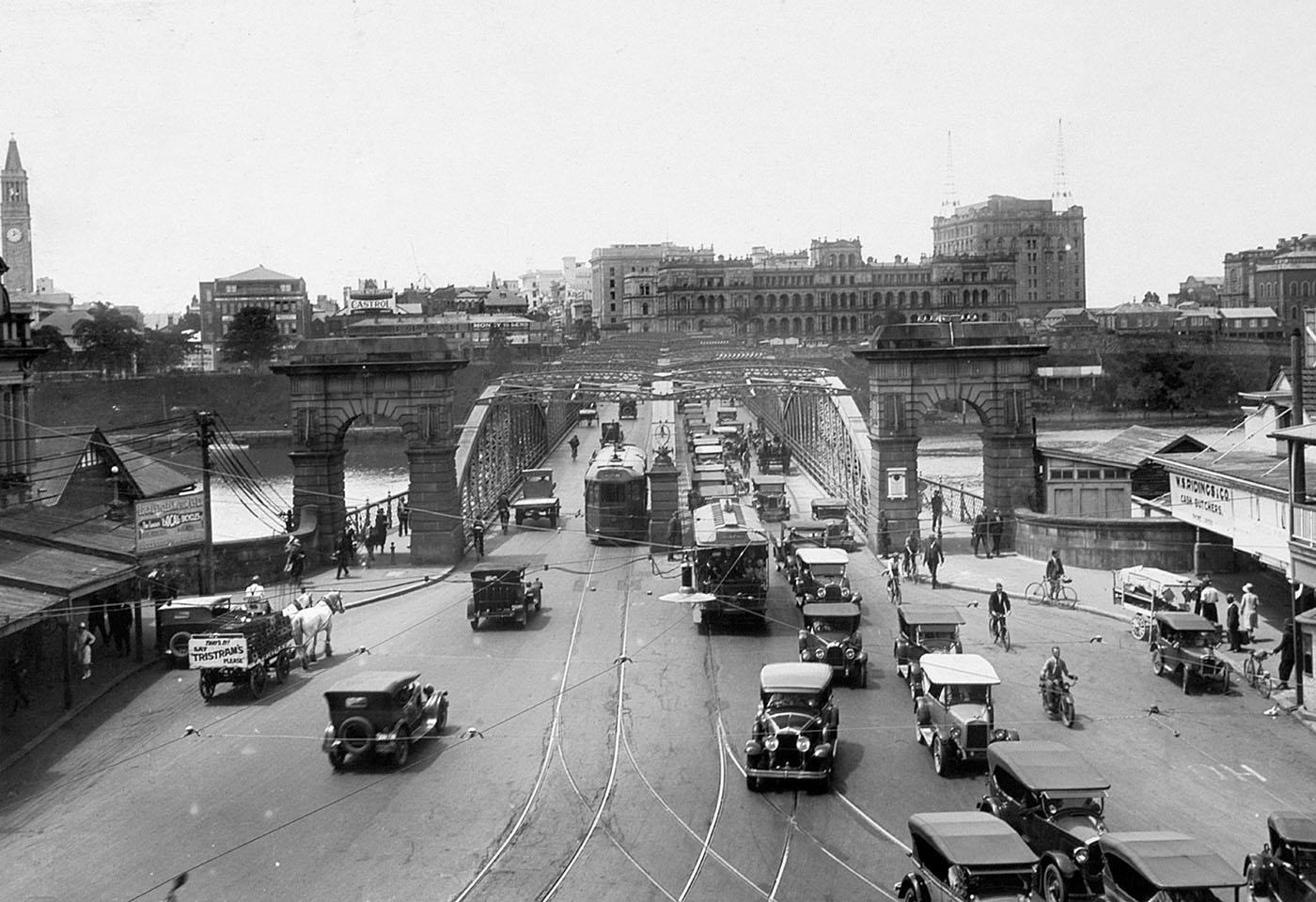 View of busy traffic passing over Victoria Bridge in October 1930