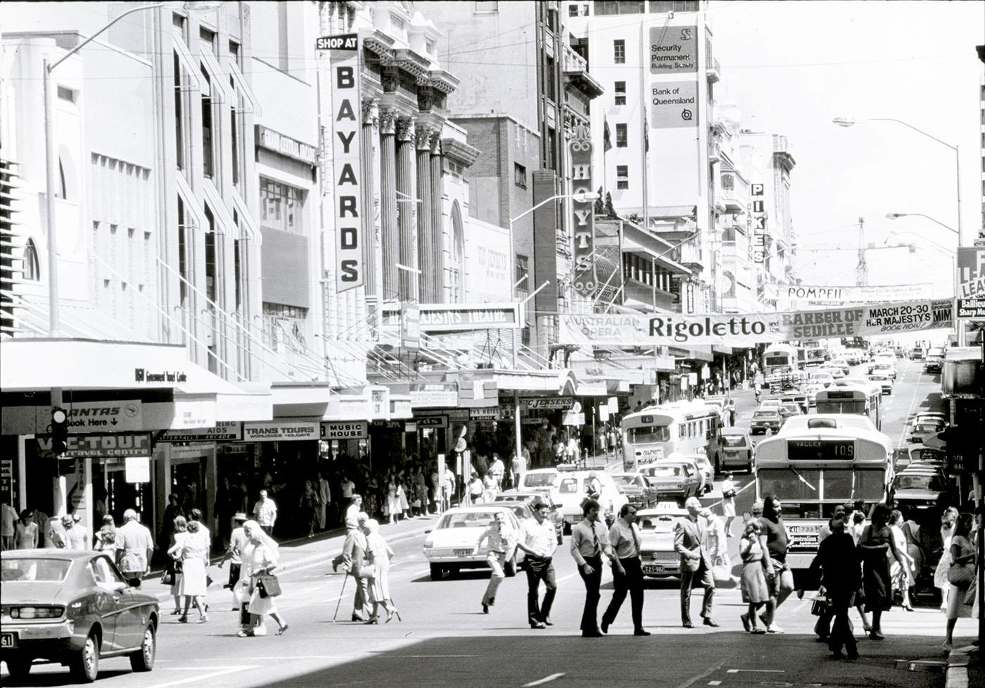 People crossing the road on a busy Queen Street