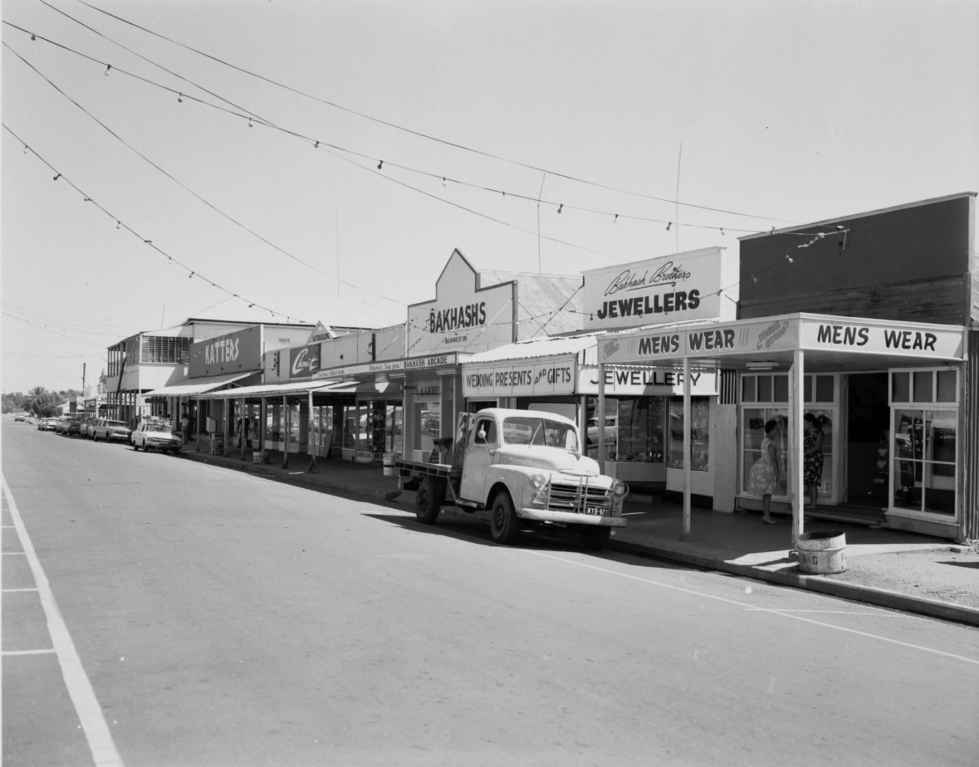 Main Street of Cloncurry showing a truck parked in front of a row of shops