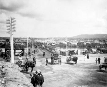 View of Victoria Bridge with horses and carriages crossing