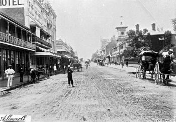 George Street with horse-drawn carriages and pedestrians.