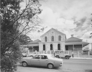 View of the the Court House, Ipswich from the road with a car driving in front of the court