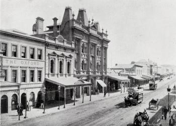 View of Queen street with horse-drawn trams in front