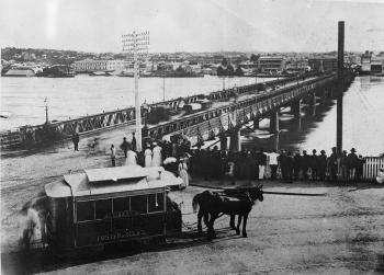 Victoria Bridge with flood waters and horse-drawn tram in foreground, 1893
