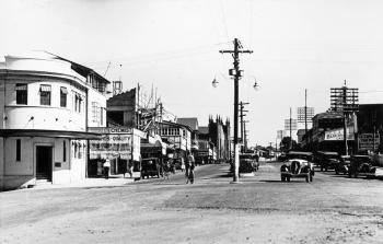 View of a Rankin Street, showing some older style cars, buildings and telegraph poles