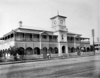 Exterior of the post office in Mackey, showing Queenslander style architecture and clock tower