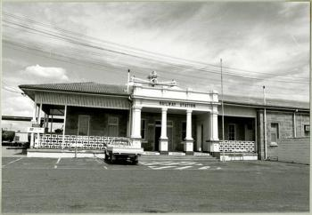 Exterior of the public railway station in Warwick Queensland showing an empty carpark