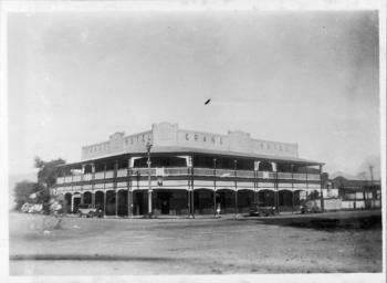Exterior view of the Grand Hotel in Cairns from the across the street showing the facade and verandahs