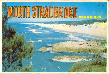 color cover of postcard book. picture of South Gorge and Main Beach.