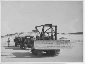 image of dozer on beach